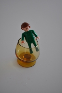 green_toy boy in miniature brandy glass