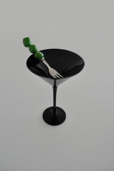 black martini glass olive cocktail fork