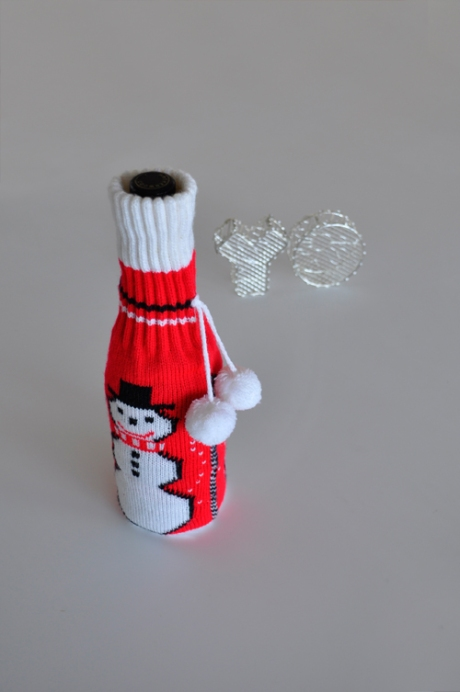 knitted reds wine bottle cover pom poms