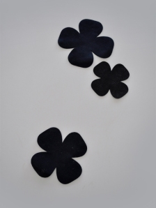 3 black suede laser cut flower coasters