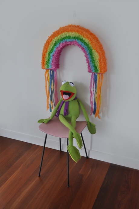 Kermit under rainbow pinata