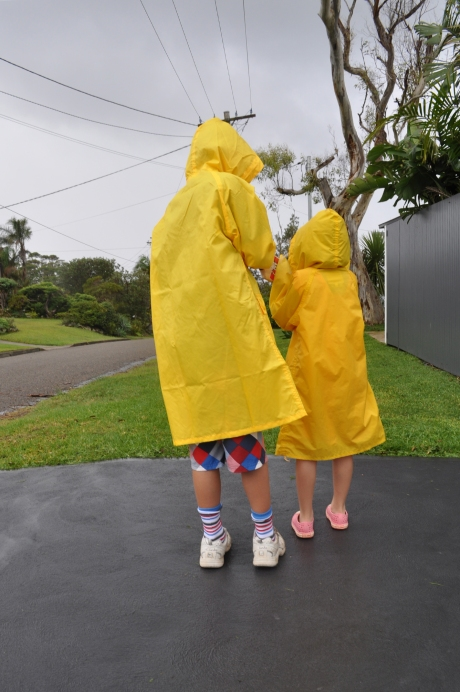 Kids in yellow rain coats