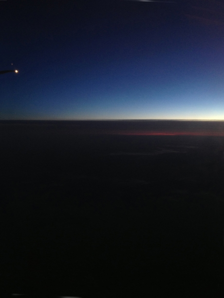 Deep blue horizon plane window shot