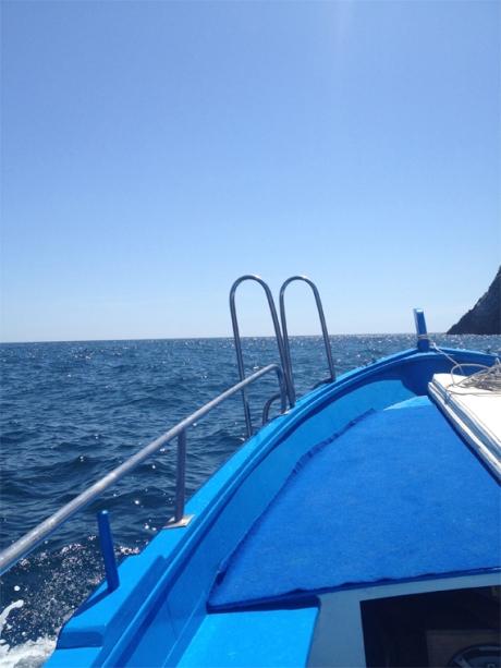 Mediterranean sea cobalt blue boat