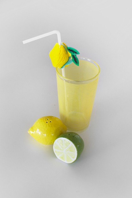 Lemon juice vintage yellow glass fruit straws salt and pepper lime