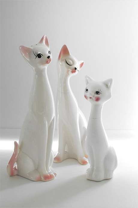 three vintage retro cats on the shelf