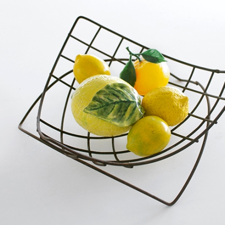 bowl of fake lemons wire fruit bowl SQ 2